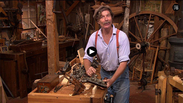 Video player: Roy Underhill on the set of the Woodwright's Shop holding a stanley combination plane