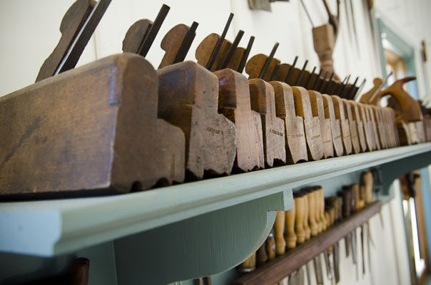 Woodworking Hand Tool Shelf Filled With Molding Planes, Wood Chisels, And Plow Planes