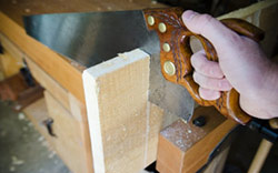 Henry Disston & Sons No. 16 Crosscut Panel Hand Saw Cutting a poplar board in a woodworking workbench vise