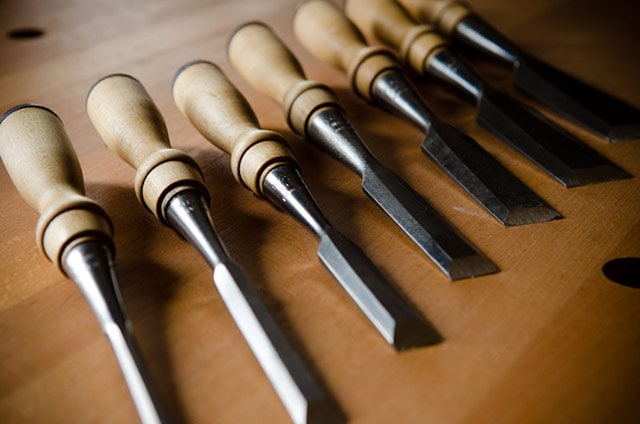 Stanley 750 Wood Chisel set spread out on a woodworking workbench