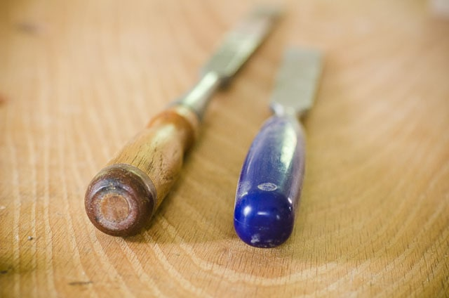 wood chisel handle and plastic chisel handle on woodworking workbench