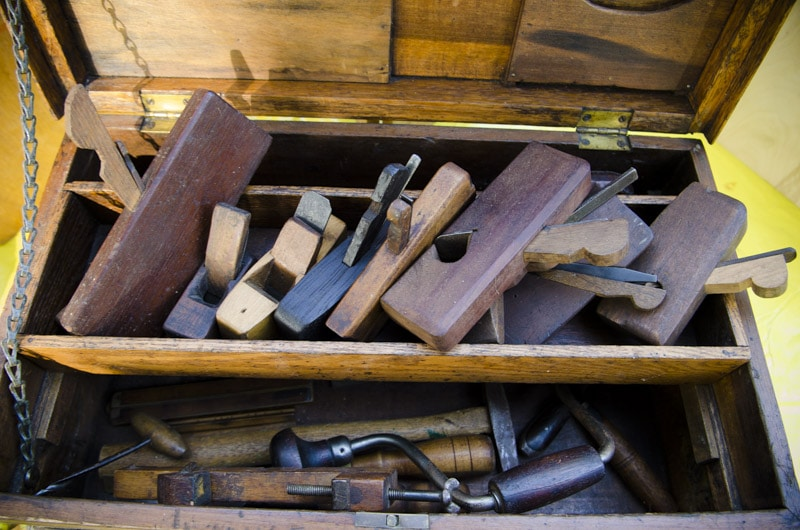 Antique tool chest with wooden hand planes