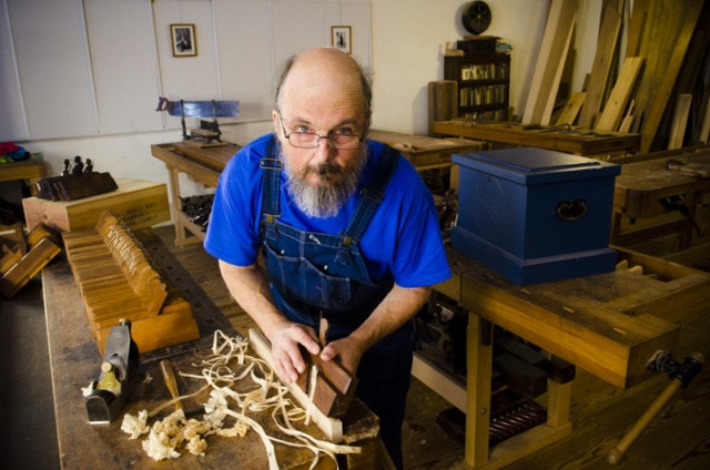 Bill Anderson Using Molding Planes To Cut Profiles On A Woodworking Workbench