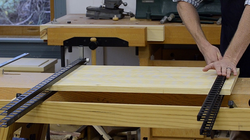 Then I add the top bars  insert the other pins  and press down on the first  top bar. How to Glue Up a Table Panel with Panel Clamps   Wood and Shop