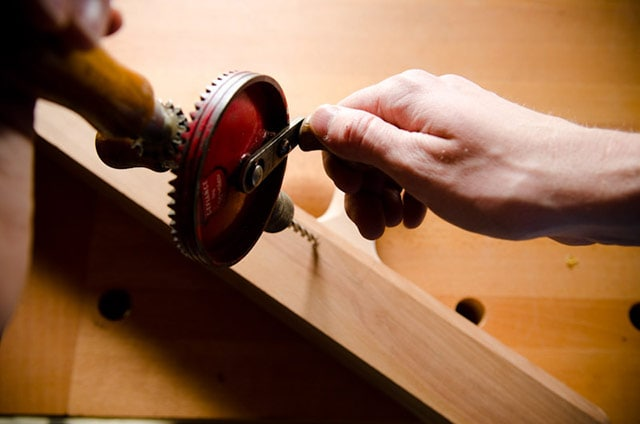 Boring A Hole In A Wood Plane With A Manual Hand Drill Or Egg Beater Drill