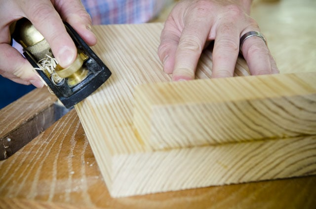 Cutting a bevel on a new bench hook with a Lie-Nielsen low angle rabbet block plane on a woodworking workbench