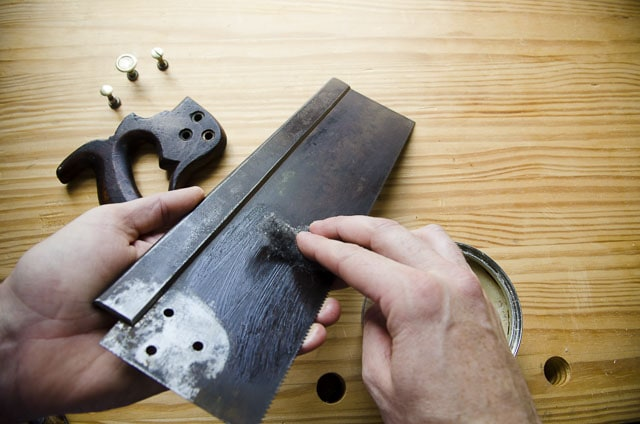 Waxing a refurbished antique saw plate from a disassembled Simonds 97 hand saw.