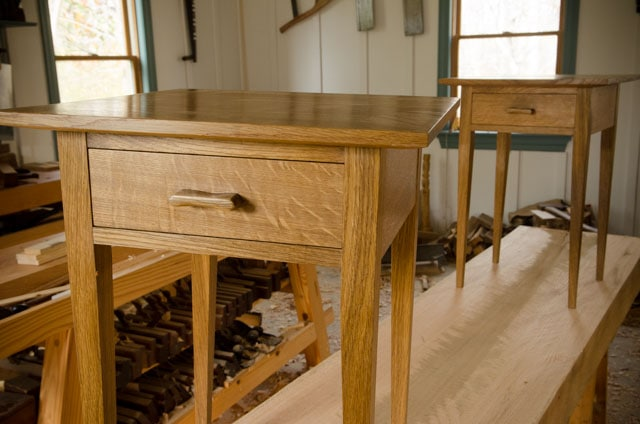 Two quartersawn white oak night stands sitting on a Roubo workbench slab
