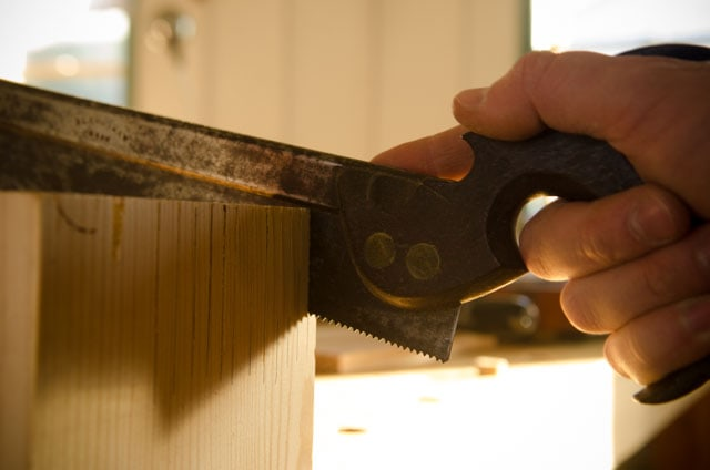 Testing the cut of a newly sharpened antique dovetail saw on a pine board