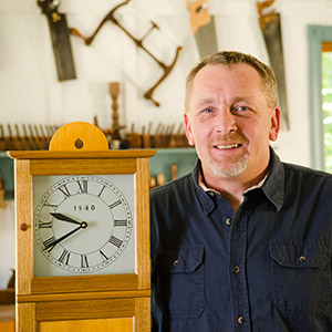 Will Myers woodworking instructor at the woodandshop traditional woodworking school with shaker clock