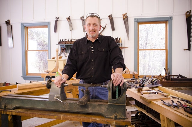 Will Myers standing at a woodturning lathe