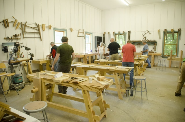 Woodworking students working at traditional woodworking benches at the Wood And Shop traditional woodworking school