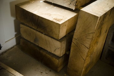 Stack of thick slab lumber for workbench tops