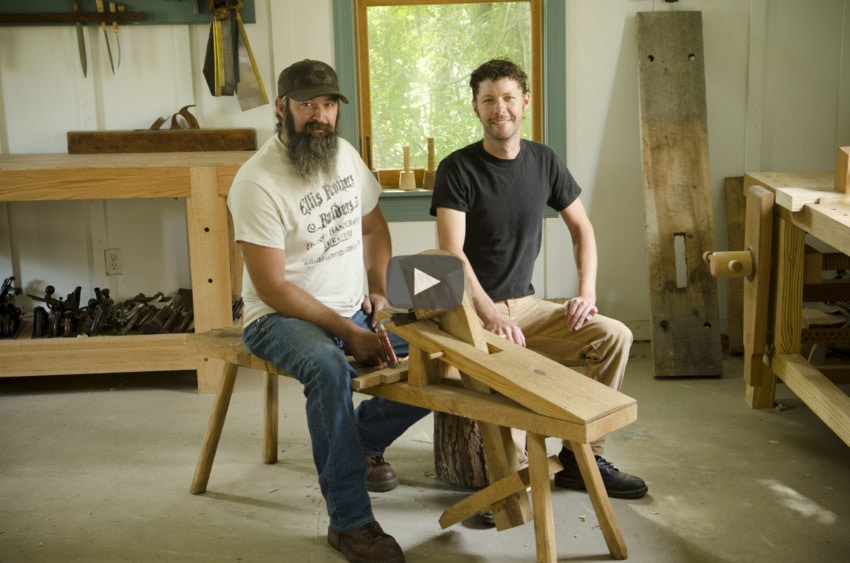 Ervin and Willie Ellis sitting on a woodworking shaving horse at Wood And Shop woodworking school