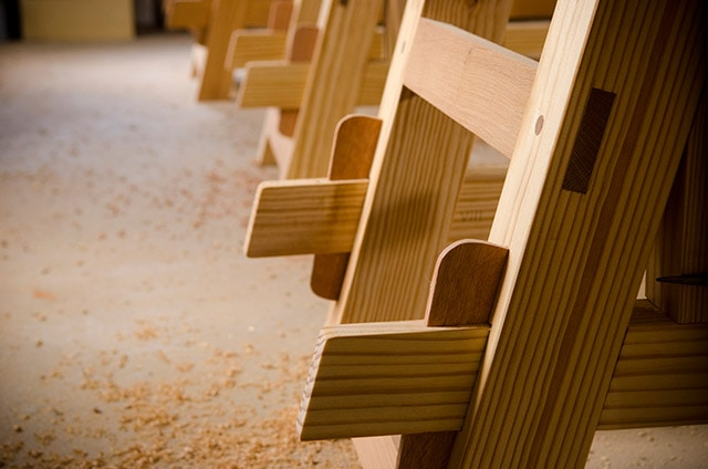 A row of Moravian workbench legs that feature the wedged tusk tenon joint or keyed tenon joinery
