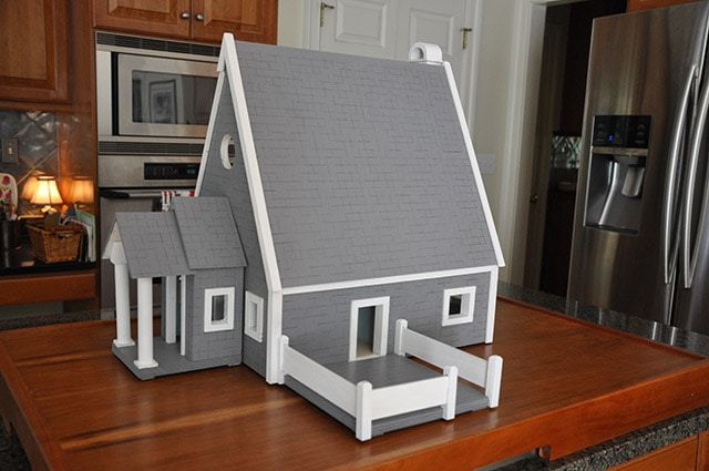 Fancy gray doll house built by james huggett