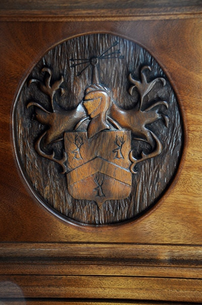 Desk with wood carving of knight with a shield with deer