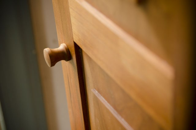 Shaker door knob on a cherry hanging shaker wall cupboard built by Joshua Farnsworth