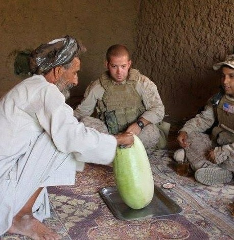 Erik Florip Toolworks Woodworking United States Marine Corp solider with middle eastern man with a watermellon