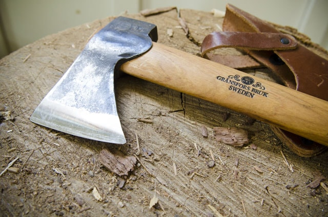 Gränsfors Bruk carving hatchet on a wood log stump with Sweden mark