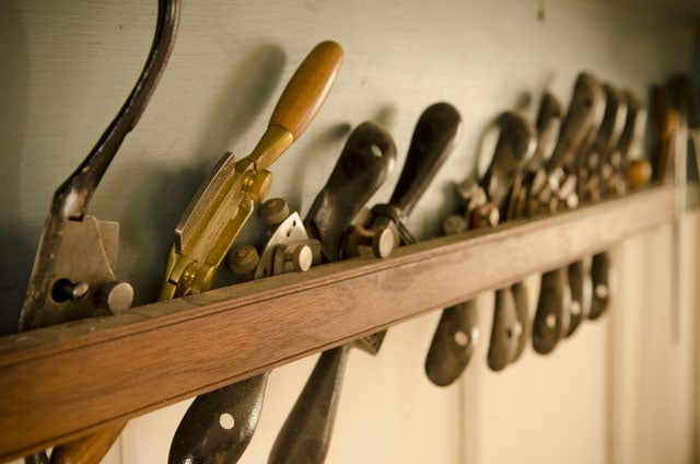 Spokeshaves spoke shaves lined up on a tool shelf