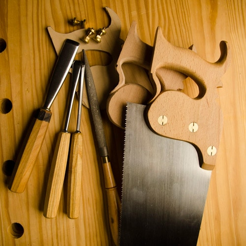 Stages of making a panel saw with gouges & tools