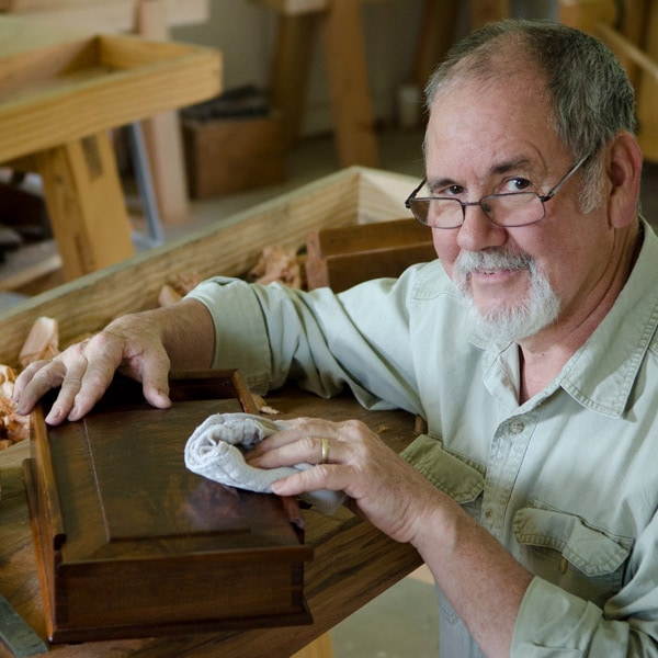David Ray Pine adding finish to dovetail wood box