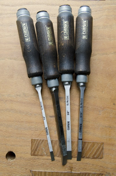 Four Narex Mortise chisels or mortice chisels sitting on a Roubo workbench