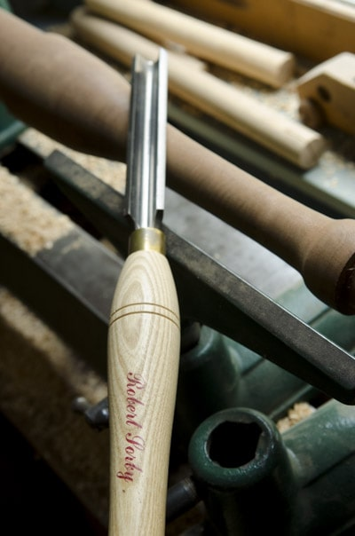 Robert Sorby 3/4 inch roughing gouge Wood turning tools guide in front of a wood turning lathe