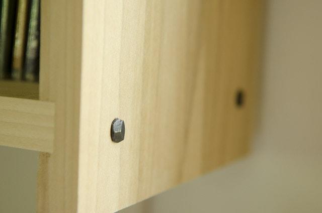 Rose head nails on a wood shelf