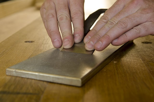 honing or sharpening a hand plane iron blade on a diamond stone