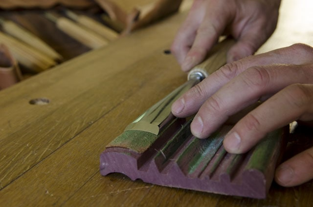 Stropping a woodworking carving chisel on a leather stop block