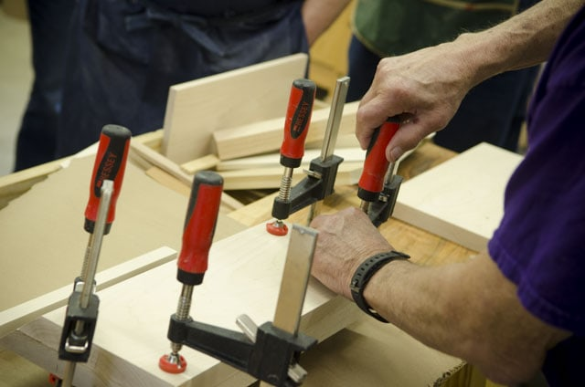 F style woodworking clamps gluing up a donkey's ear shooting board