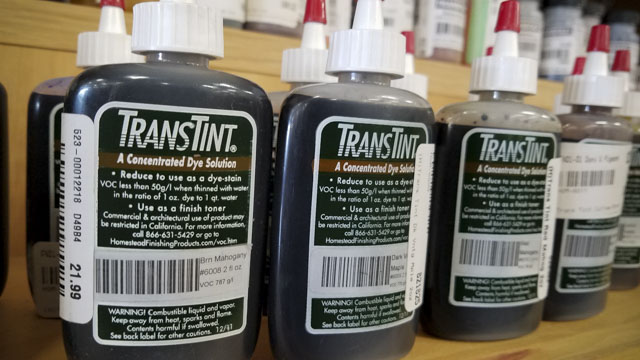 Bottles of TransTint wood dye on a shelf