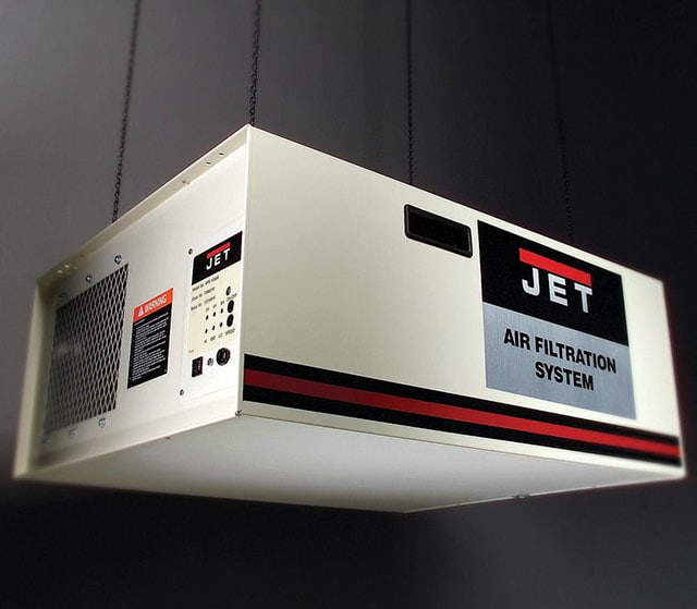 JET air filtration system hanging from a ceiling