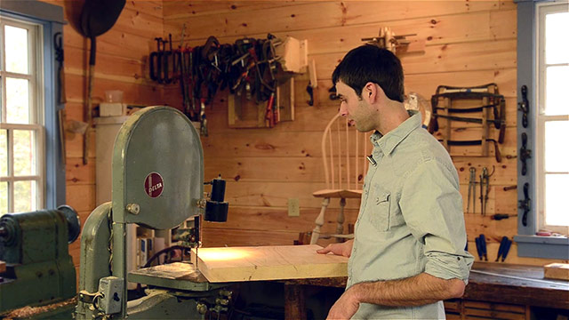 Elia Bizzari cutting out a Windsor chair seat on a woodworking bandsaw
