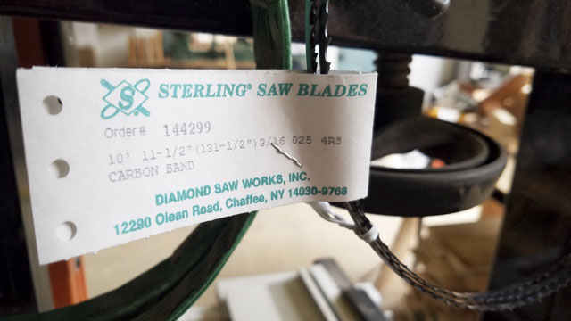 bandsaw blade with a tag that says Sterling saw blades diamond saw works