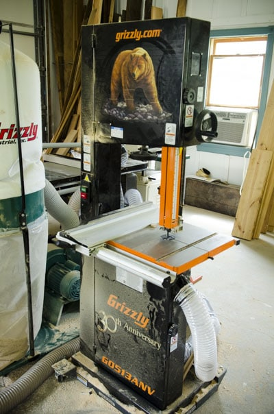 Grizzly G0513ANV 17 inch 2 HP Bandsaw Anniversary Edition in a woodworking workshop