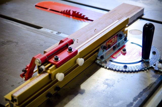 Incra miter gauge on a table saw with saw blade in background