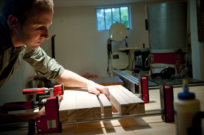 Joshua Farnsworth clamping up maple lumber with bessey woodworking clamps