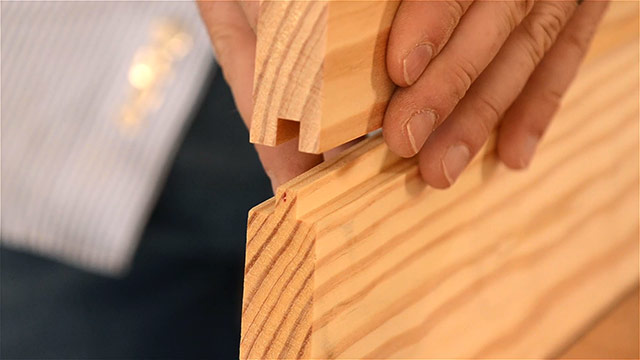 Woodworker holding a tongue and groove joint apart