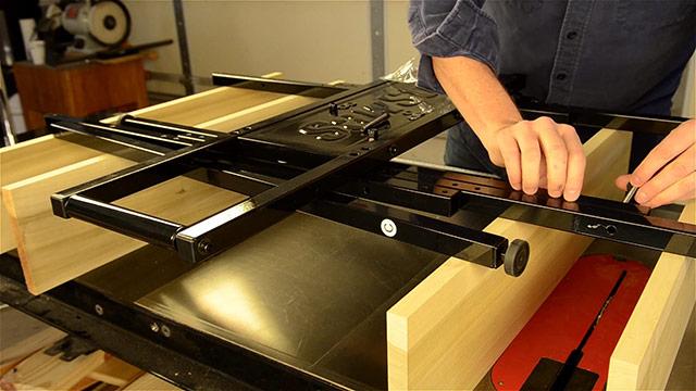 Joshua Farnsworth assembling a SawStop folding outfeed table