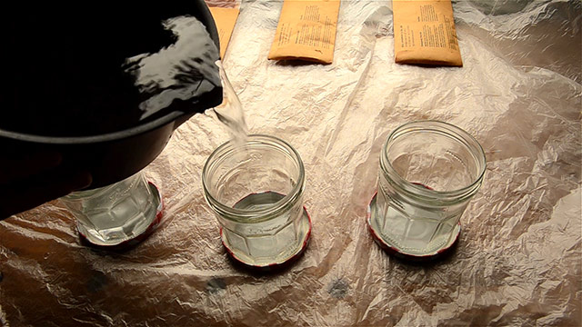 Pouring water into three jars in preparation for mixing and applying three different shades of Lockwood aniline dye