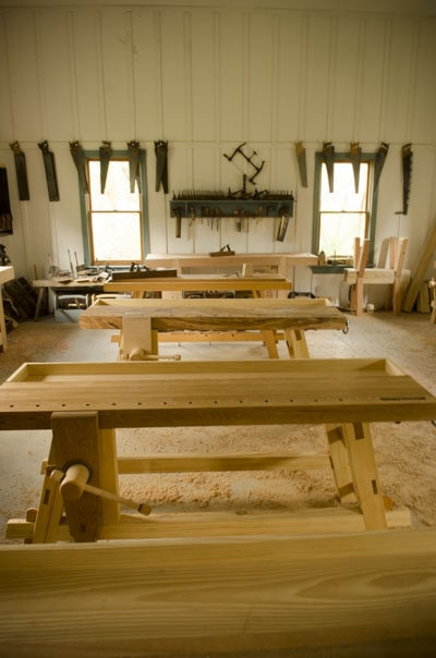 portable moravian workbenches in the wood and shop traditional woodworking school with hand tools in the background