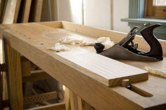 Portable Moravian workbench with handplane and board in the bench dog wagon vise