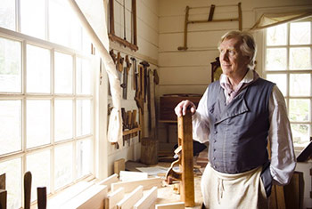 Kaare Loftheim at the Colonial Williamsburg Hay Cabinet maker's shop with a jointer hand plane