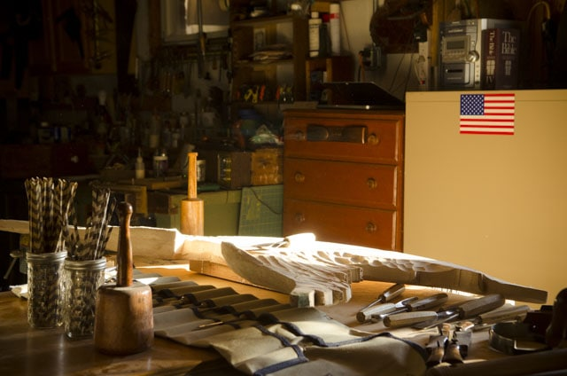 William Brown's woodworking workshop with wood carving tools and bellamy eagle being carved