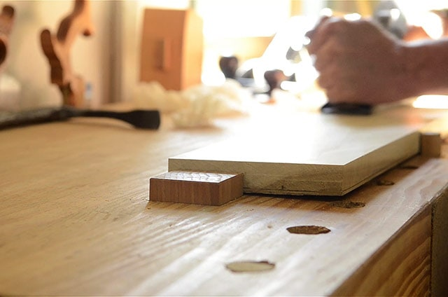 A Hand Planing Stop Supports A Board For Hand Planing With A Stanley Hand Plane On A Pine Wooden Workbench