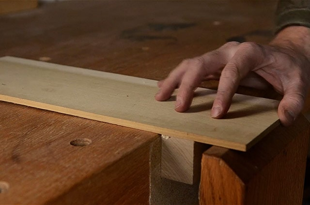 Wooden glued planing stop for workbench vise