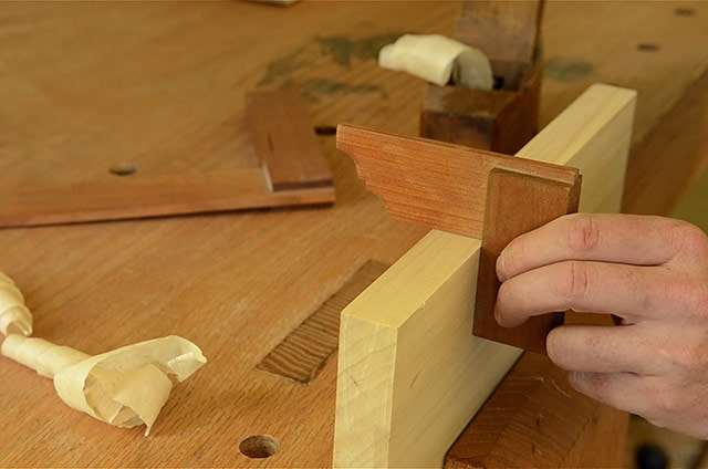 Using A Wooden Try Square To Square The Edge Of A Board